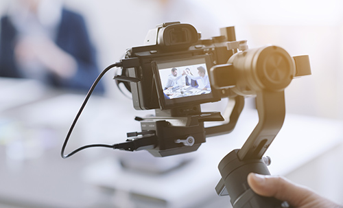Professional-videomaker-shooting-a-video